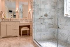 Master Bathroom- Custom Cabinets, Calcutta Gold Marble, Diana Royal Honed Tile Floor,