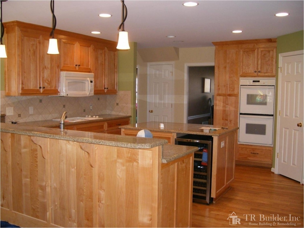Kitchen with wine cooler in island