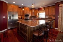 kitchen-with-custom-cabinets-and-large-island-with-granite-countertop