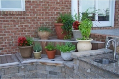 outdoor-living-showing-granite-countertop-sink-shelves-with-pots