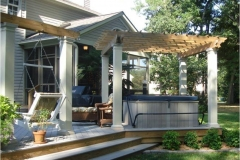 outdoor-living-with-pergola-over-hot-tub-and-a-swing