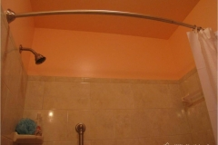 small-bathroom-remodel-after-3-showing-bowed-shower-rod